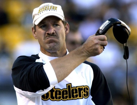 Pittsburgh Steelers coach Bill Cowher removes headset